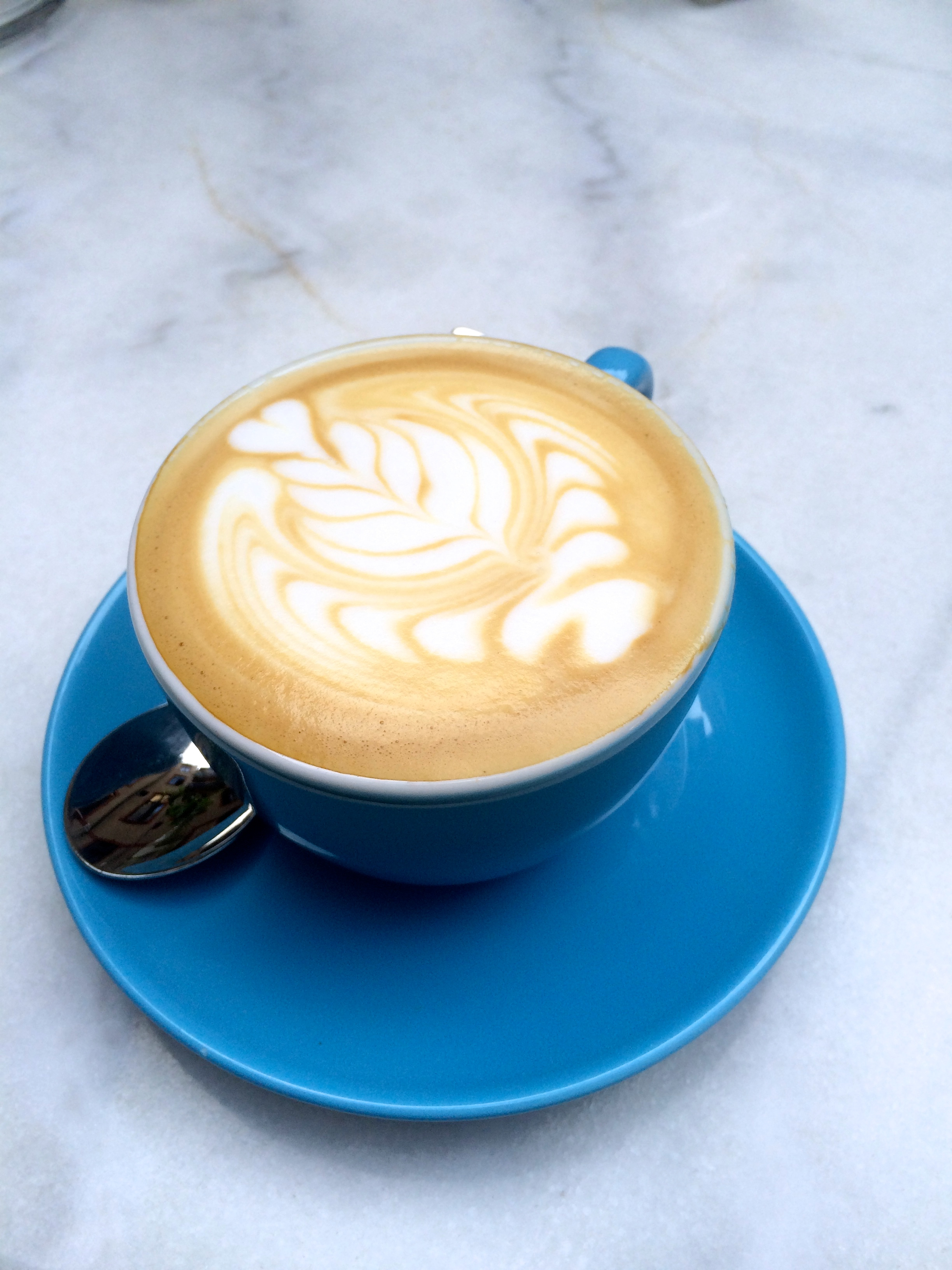 Father Carpenters cappuccino this fall at a table in the inner courtyard